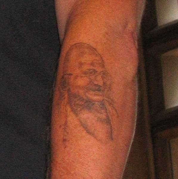Mahatma gandhi tattoos pictures to pin on pinterest for Tattoo shops junction city ks